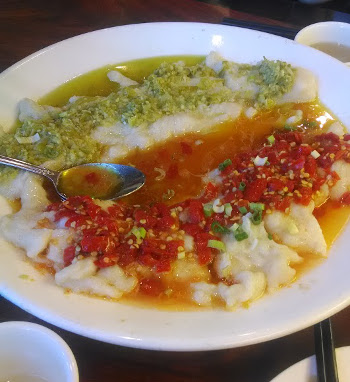 two flavors of chili sauce on an alarming amount of fish