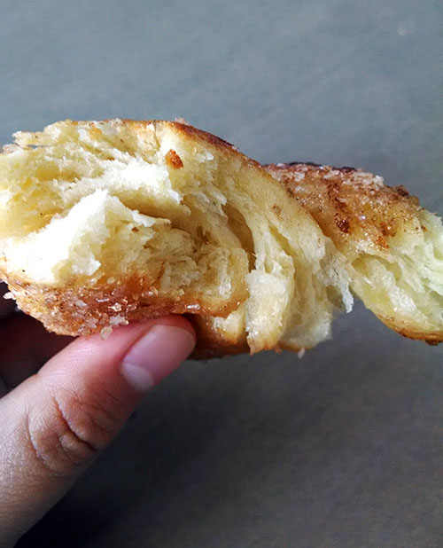 Side view of toasted cinnamon sugar cragel.